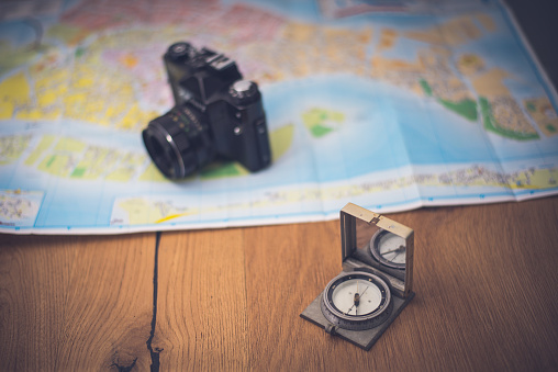 97623256 istock photo Map and compas 698196746