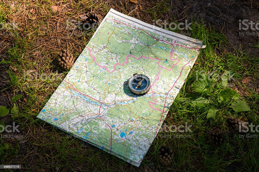 map and compass on a path in the woods – Foto