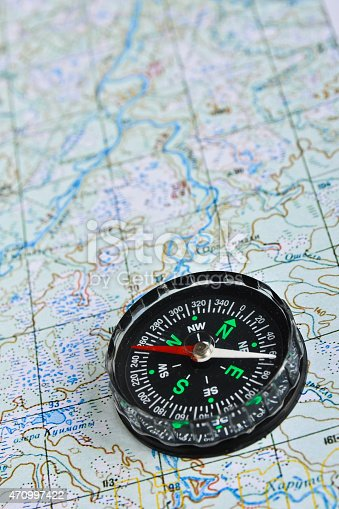 97623256istockphoto Map and compass. 470997422