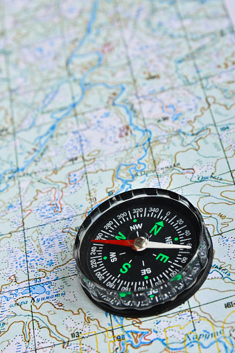 97623256 istock photo Map and compass. 470997422