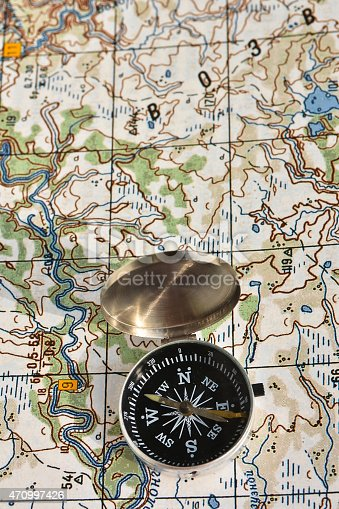 97623256istockphoto Map and compass. 470997426