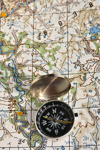 97623256 istock photo Map and compass. 470997426
