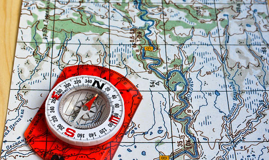 97623256 istock photo Map and compass. 479377932