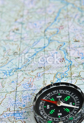 97623256istockphoto Map and compass. 479377952