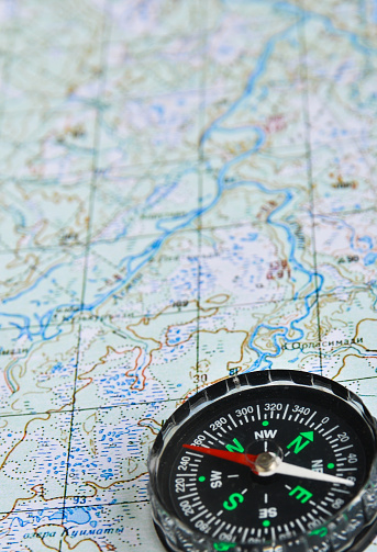 97623256 istock photo Map and compass. 479377952