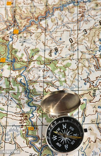 97623256istockphoto Map and compass. 479377954