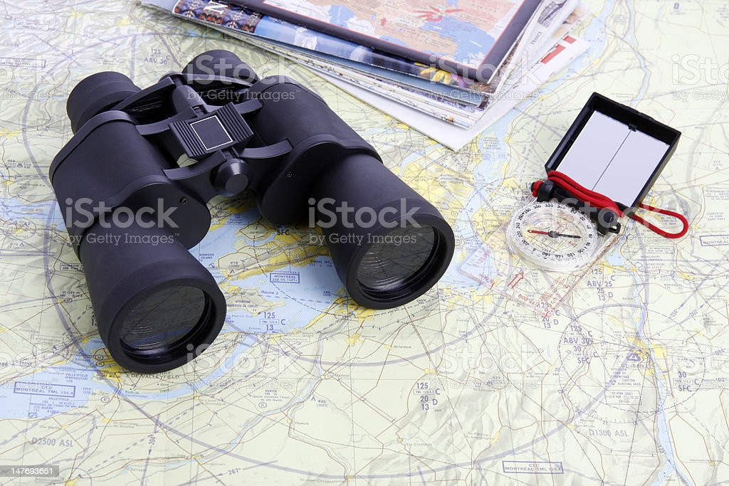 map,  Binoculars and compass - 4 royalty-free stock photo