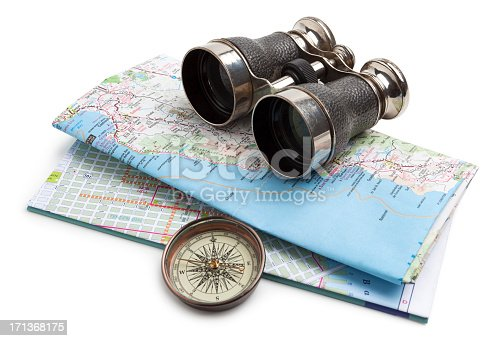 Map, compass and binoculars on white background. Map shows the Pacific coast of California.