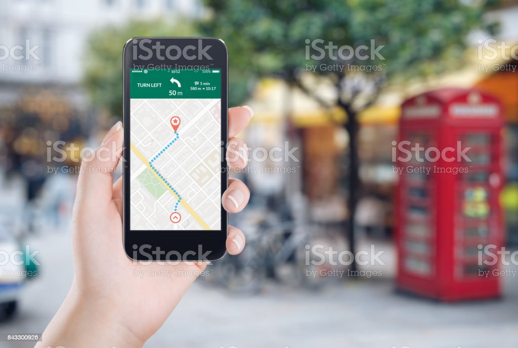 Map gps navigation application on the smartphone screen in female hand stock photo