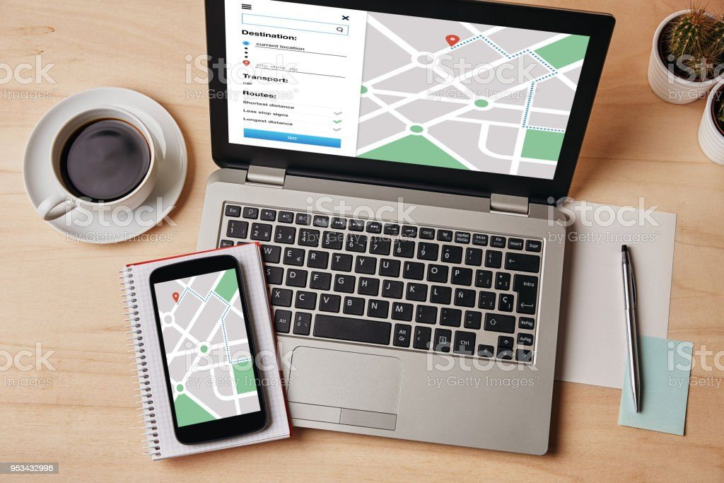 GPS map navigation app on laptop and smartphone screen. Location tracker concept stock photo