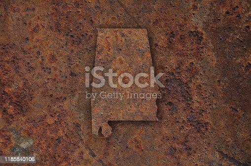 Map of Alabama on rusty metal
