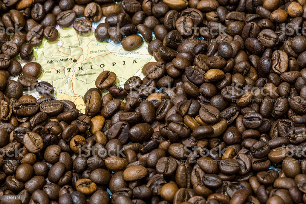 Map of Ethiopia under a background of coffee beans stock photo