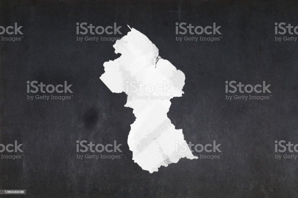 Map of Guyana drawn on a blackboard Blackboard with a the map of Guyana drawn in the middle. Backgrounds Stock Photo