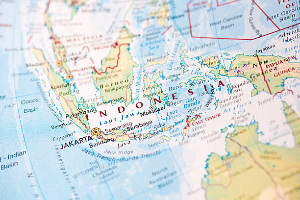Map of Indonesia on the world globe Photo map of Indonesia. Shallow depth of field, focus on the Jakarta city of the map and the area nears it. sulawesi stock pictures, royalty-free photos & images