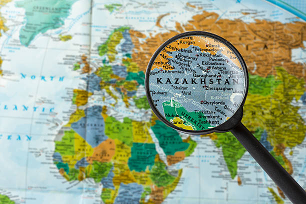 Map of Kazakhstan Map of Kazakhstan through magnifying glass kazakhstan stock pictures, royalty-free photos & images