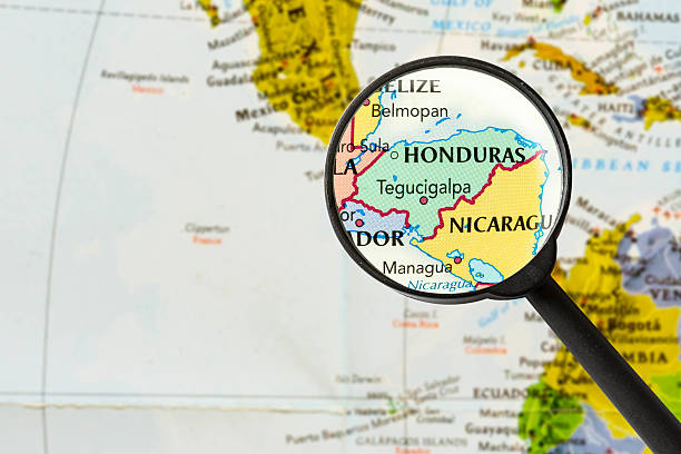 map of Republic of Honduras map of Republic of Honduras through magnifying glass honduras stock pictures, royalty-free photos & images