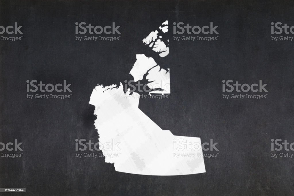 Map of the Northwest Territories drawn on a blackboard Blackboard with a the map of the Northwest Territories (Canada) drawn in the middle. Backgrounds Stock Photo