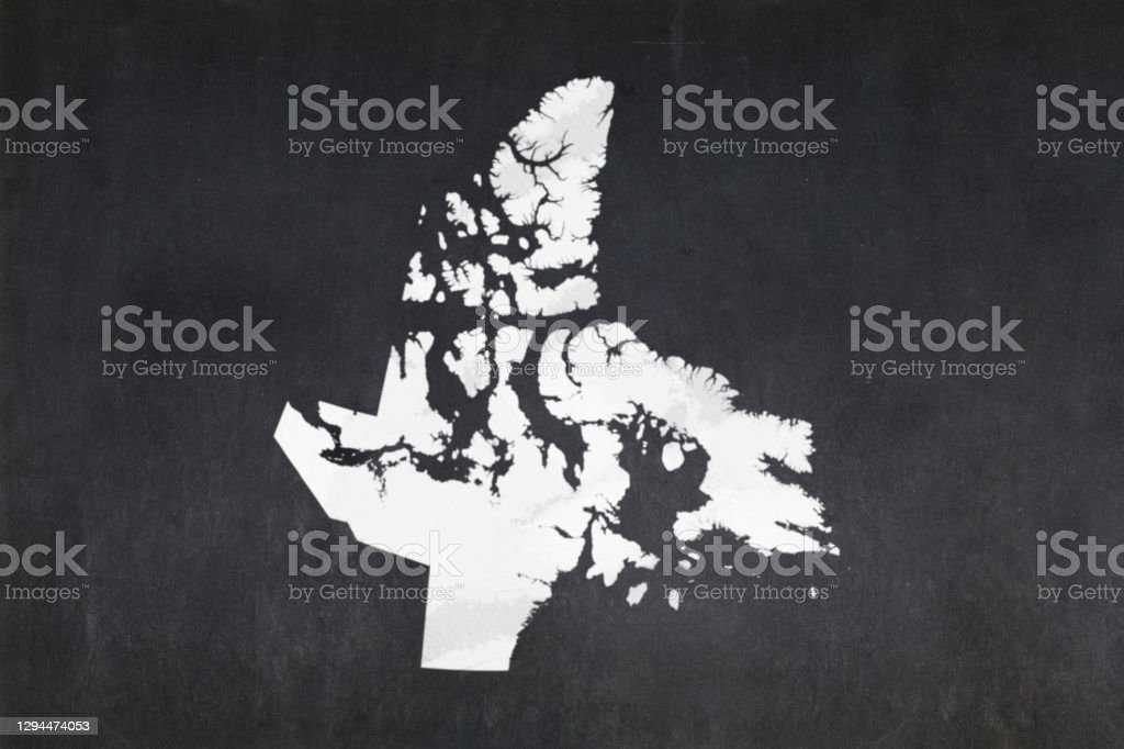 Map of the territory of Nunavut drawn on a blackboard Blackboard with a the map of the territory of Nunavut (Canada) drawn in the middle. Backgrounds Stock Photo