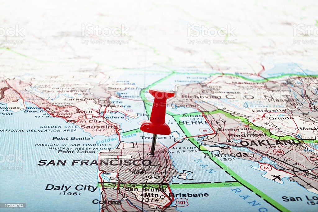 Map of the U.S. with a red push pin stuck in San Francisco. stock photo