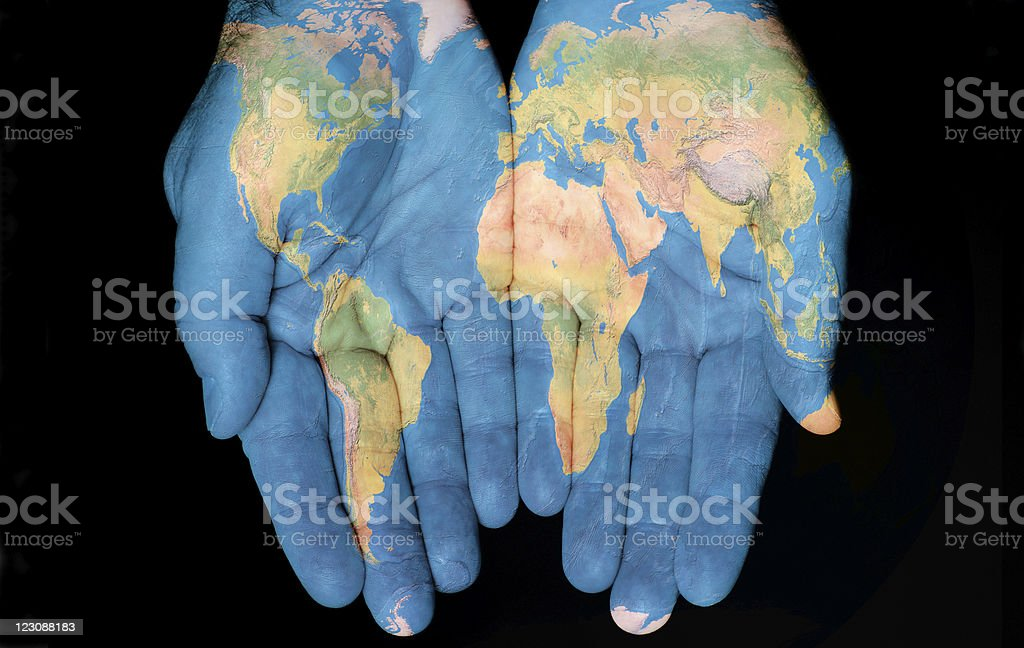 Map of the world painted on hands royalty-free stock photo