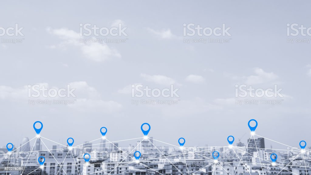 Map pin flat above blue tone city scape and network connection concept. stock photo
