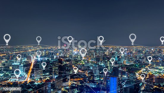 Map pin flat of city, network connection lines in Bangkok Downtown, Thailand. Financial district and business center in smart urban city in Asia. Skyscraper and high-rise buildings at night