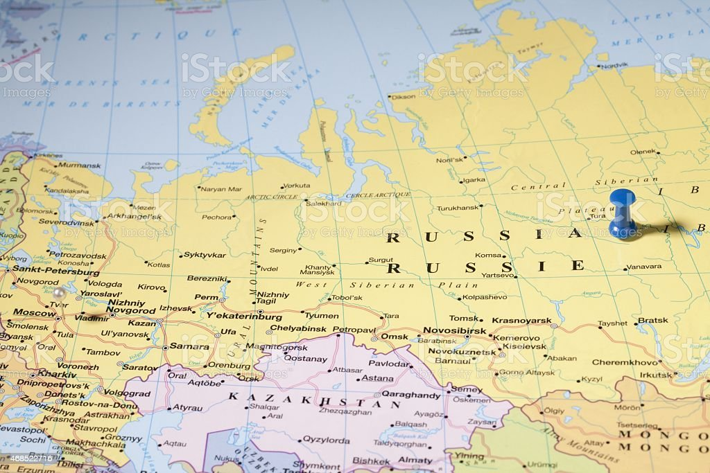 map pins on russian area over world map stock photo