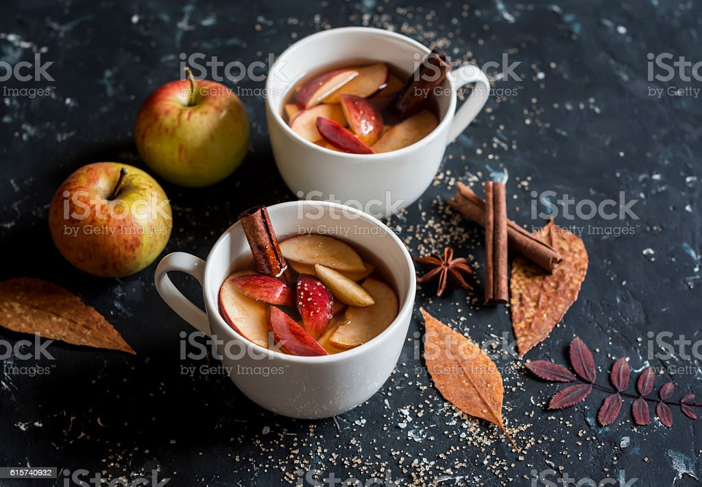 Maple apple hot cider. On a dark background. stock photo