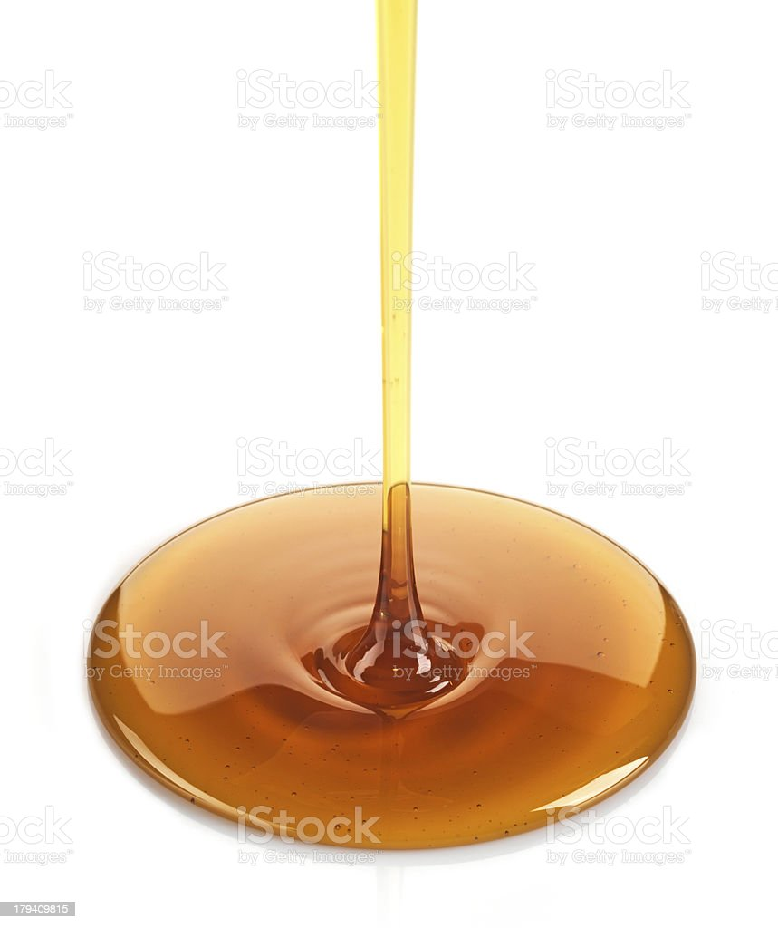 Maple syrup being poured onto white stock photo