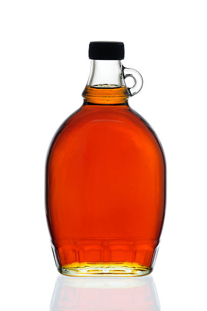 maple syrup bottle - maple syrup stock photos and pictures