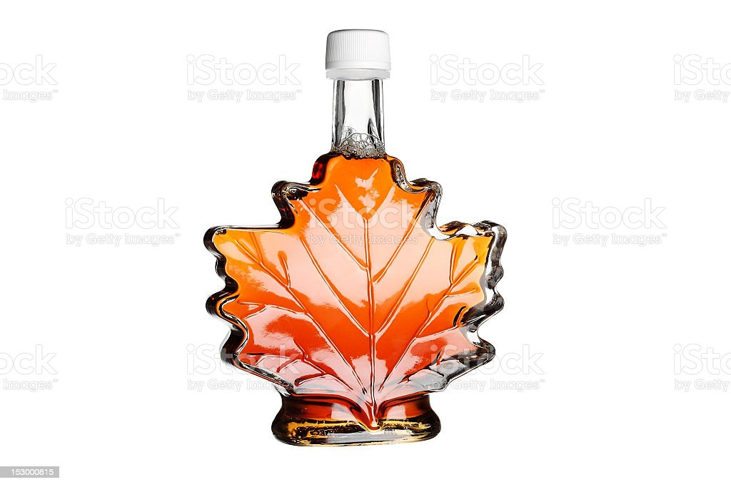 Maple syrup in a bottle shaped like a maple leaf stock photo