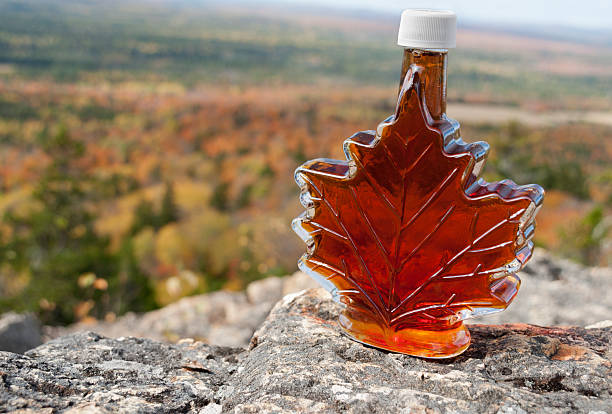 maple syrup with fall foliage - maple syrup stock photos and pictures