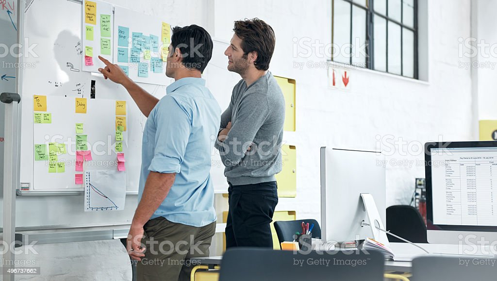 Mapping out their strategy stock photo