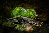 Maquoketa Caves State Park  - Looking toward an entrance to the cave, reflected in a pool of water in the foreground. A