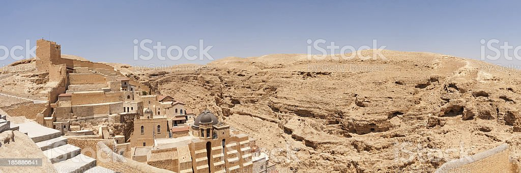 Mar Saba panoramic view against steep laminated wall canyon background royalty-free stock photo