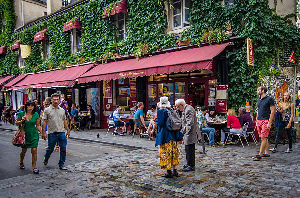 Marais street scene with older couple stock photo