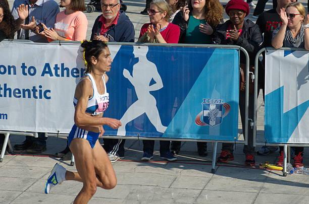 Marathon athlete approaches the finish line stock photo