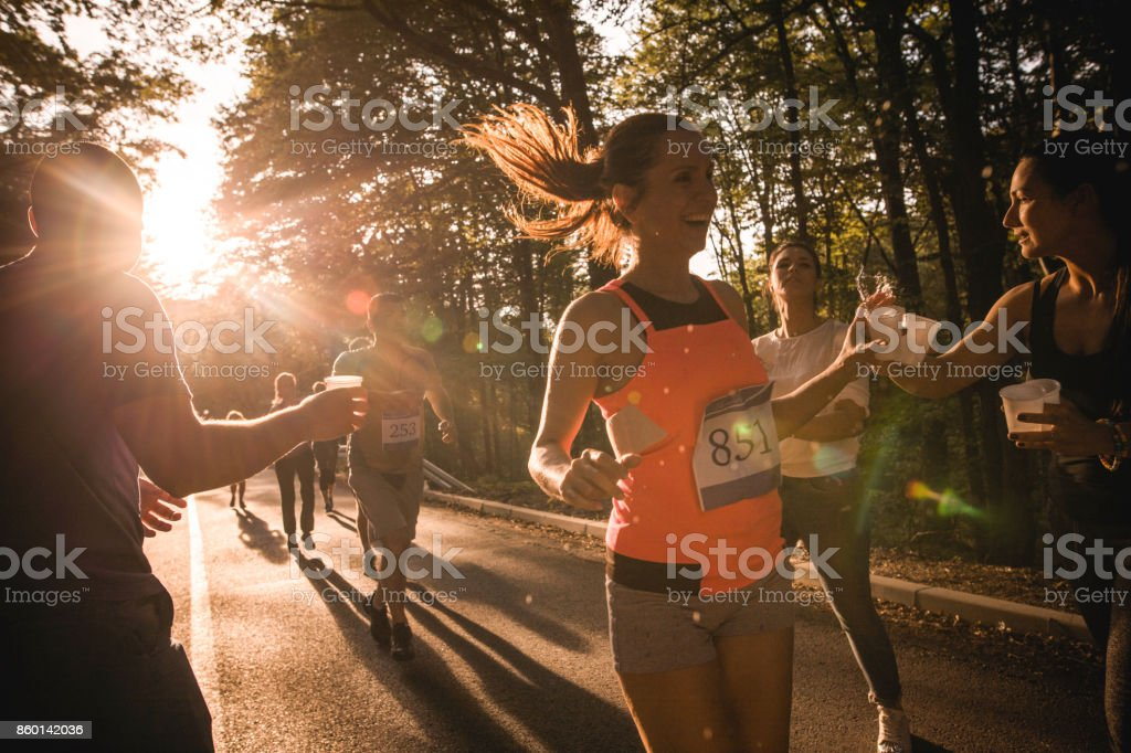 Marathon race refreshment at sunset! stock photo