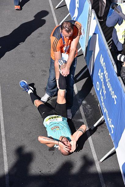 Marathon Runner in extreme pain stock photo