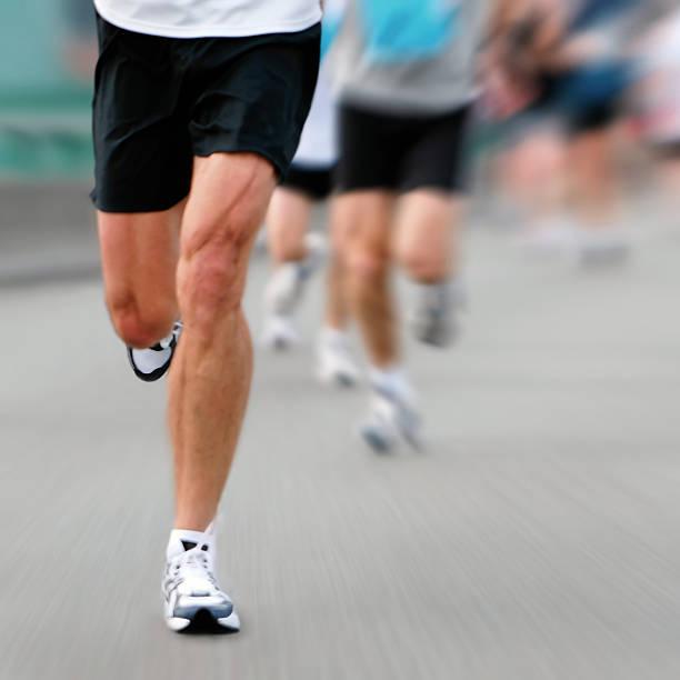 marathon runner - boston marathon stock photos and pictures