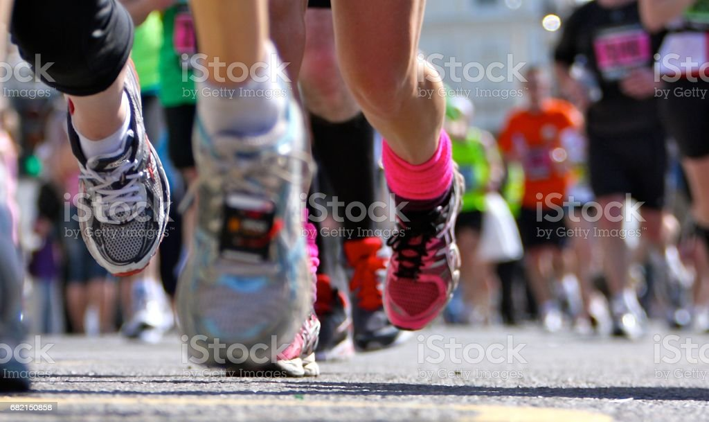 Marathon Runners close up legs and shoes stock photo