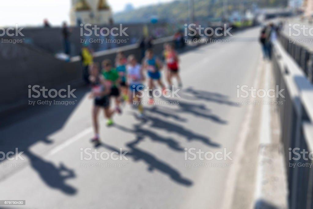 Marathon runners, defocused image