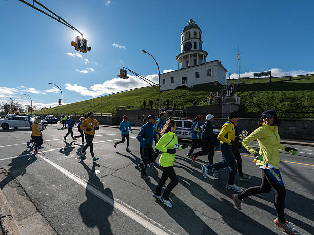 marathon runners escort the tree for boston - boston marathon stock photos and pictures