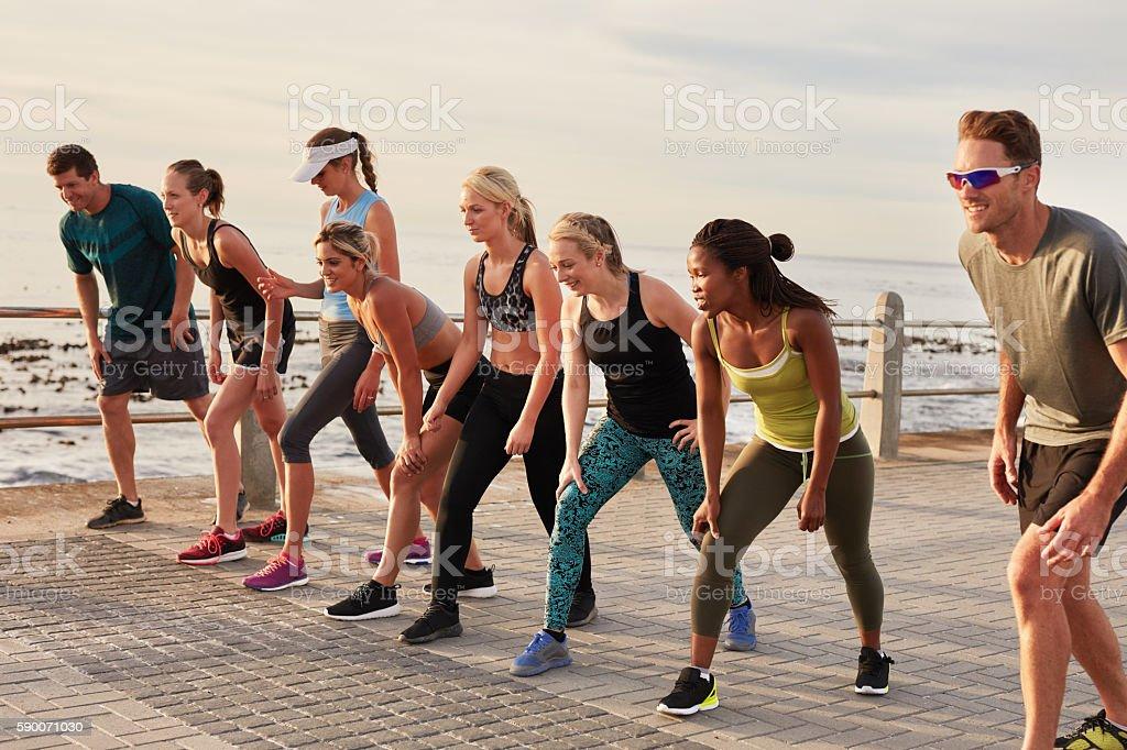 Marathon runners on starting line stock photo