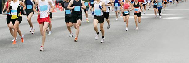 marathon runners - boston marathon stock photos and pictures