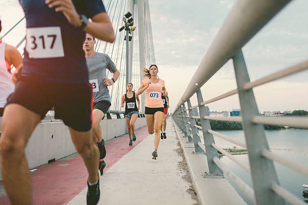 marathon runners. - marathon stock photos and pictures
