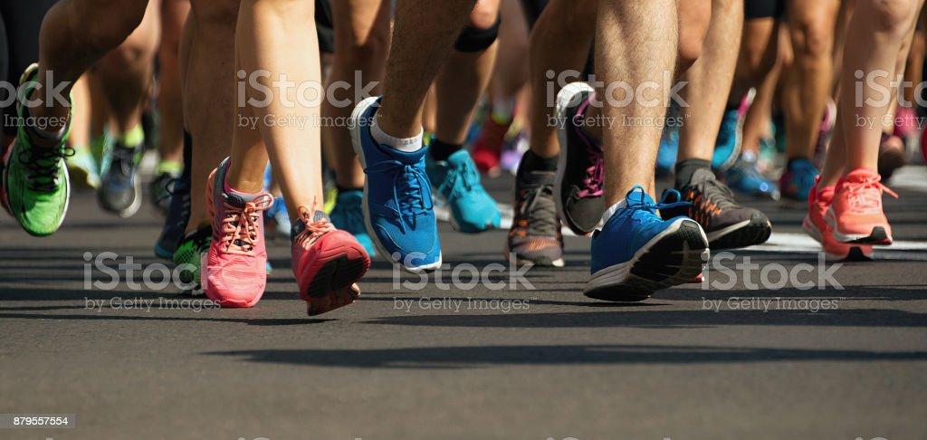 Marathon runners running on city road stock photo