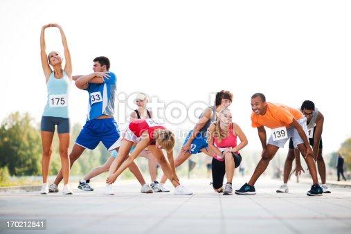 istock Marathon runners stretching 170212841
