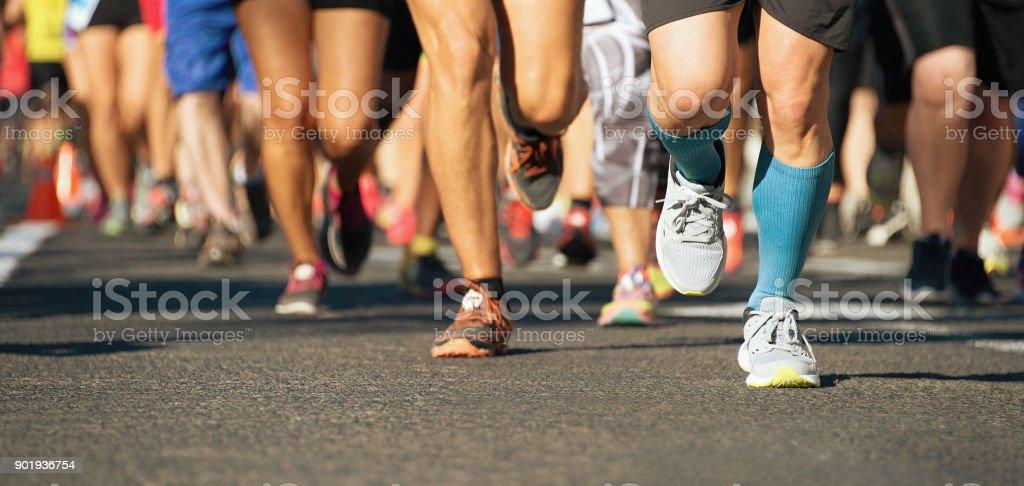 Marathon running race in the light of evening stock photo