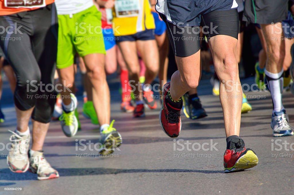 Marathon running race, people feet on road stock photo